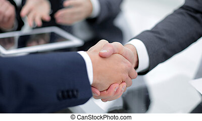 Two confident business man shaking hands