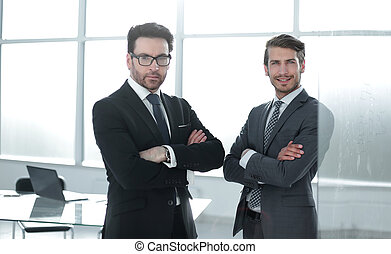 two confident business partners standing in the office