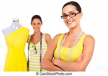 two confident fashion designers portrait on white