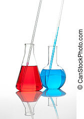 Two conical laboratory flasks with a colored liquid