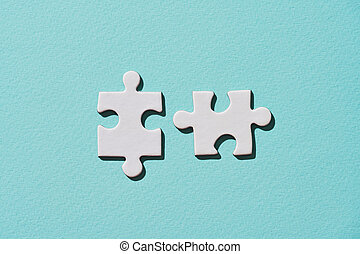 Two connecting puzzle piece.