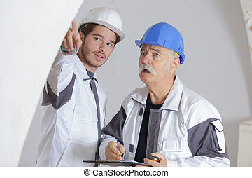 two construction workers at site