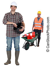 Two construction workers on a white background