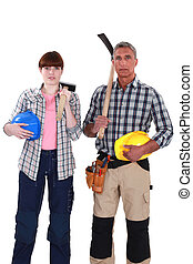 two construction workers posing together