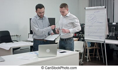 Two corporate executives having business discussion in office
