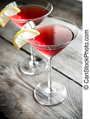 Two cosmopolitan cocktails on the wooden background