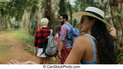 Two Couple With Backpacks Trekking On Forest Path, Young...