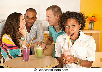 Two Couples Dining Out - Two couples at a cafe drinking...