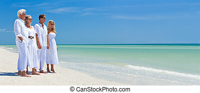 Two Couples Generations of Family Holding Hands on Tropical Beach