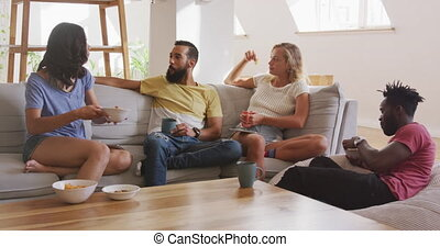 Two couples having breakfast together at home