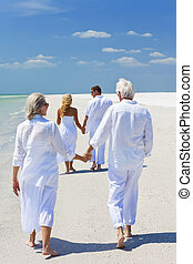 Two Couples Holding Hands on Beach