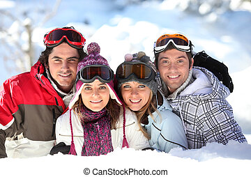 Two couples in a ski slope