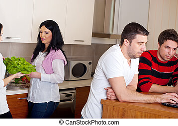 Two couples in kitchen