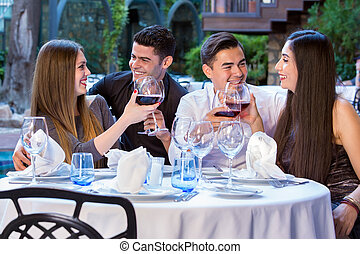 Two couples in restaurant on double date.