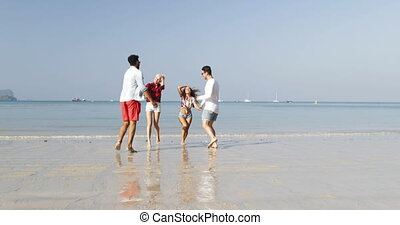 Two Couples Running On Beach To Water Man Hold Woman Hands Happy Cheerful People Embrace Talking Tourists On Vacation