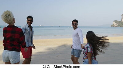 Two Couples Running On Beach To Water Man Hold Woman Hands Happy Cheerful People Tourists On Vacation