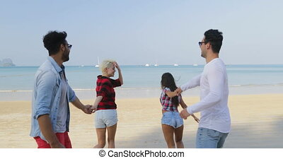 Two Couples Running On Beach To Water Woman Hold Man Hands Happy Cheerful People Tourists On Vacation