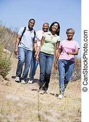 Two couples walking on path smiling