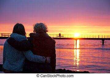 two couples watching the sundown