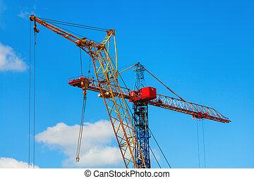 Two cranes, blue sky