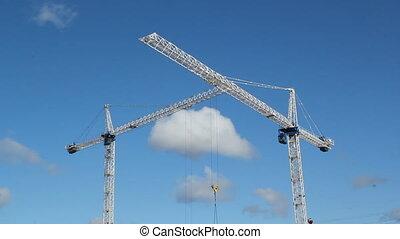 Two cranes.