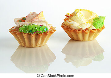Two cream cakes on a light background