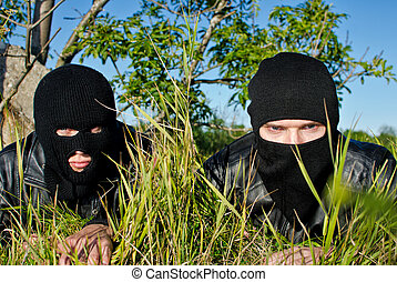 Two criminals getting ready for robbery