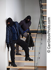Two criminals on stairs - Two masked and armed criminals...