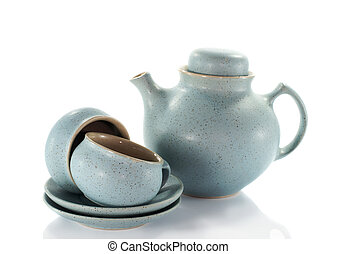 two crockery teacups and teapot on white