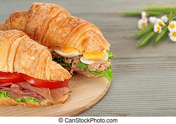 croissant sandwiches on a cutting board
