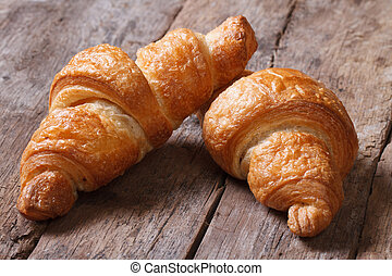 two croissants on an old wooden table