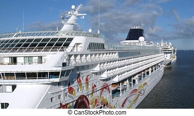 Two cruise liners stationed in port, time lapse