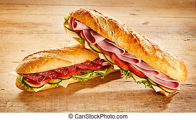 Two crusty baguettes with salami and ham