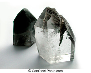 Two Crystals - Two backlit quartz crystals isolated on a...
