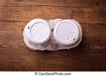 two cup of coffee on wood table