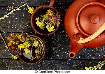 Two Cup of herbal tea - tutsan, sagebrush, oregano, ...