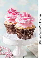Two cupcakes with rose