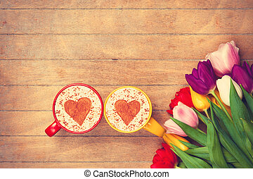 Two cups of Cappuccino and tulips