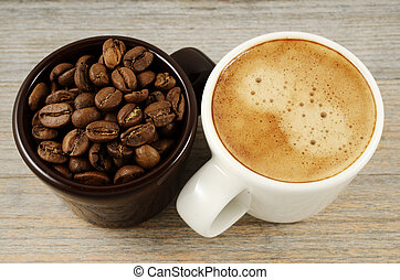 two cups of coffee and beans