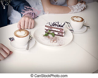 Two cups of coffee and a piece of wedding cake bride make suggestions