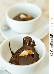Two cups of hot chocolate with nuts