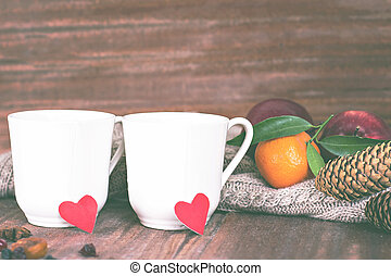 Two cups of tea in a romantic setting.