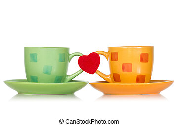 Two cups with red heart