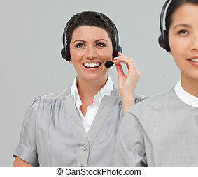 Two Customer service agents with headset on