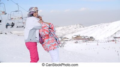 Two cute attractive young women at a ski resort