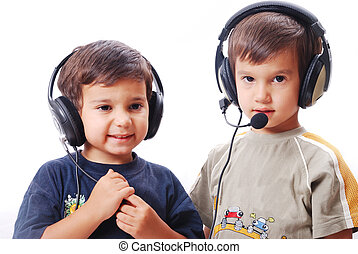 Two cute boys with headphones on