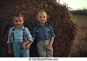 Two cute brothers leaning on the sheaf - Two cute brothers ...