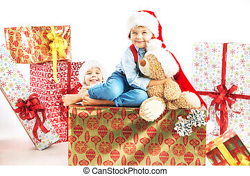 Two cute brothers with presents