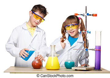 Two cute children at chemistry lesson making experiments...