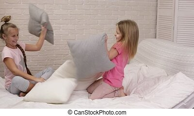 two cute children girls playing in the bedroom. - two cute...